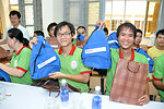 Hearing Impaired Graduates receive USAID 50th shoulder bags on June 22, 2011.