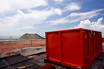 August 7, Container waits near beach for oil waste