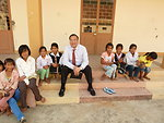 U.S. Consul General Le Thanh An visits with children at the Kon Ray Boarding School