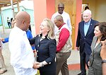 Secretary Clinton Is Welcomed By Haitian President Martelly