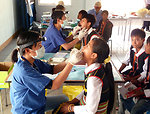 Children receive dental screening and care at the USAID-sponsored Kon Ray School