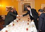 Assistant Secretary Blake Shakes Hands With Bangladeshi Foreign Secretary Mijarul Quayes