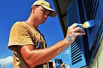 Australian Army Combat Engineer Sapper Tim Kesby Paints Window Shutters
