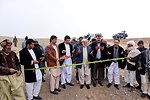 The Herat Provincial Governor and the Kushk Rabat-e Sangi District high officials cut the ribbon to inaugurate the road rehabilitation project in Khowja Gul Baidak village on December 15th