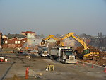 September 14, 2011 Trucks are loaded with debris at the Aerovox demolition site