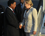 Secretary Clinton Is Greeted By Tanzanian Foreign Minister Membe