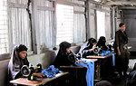 Refugee Women Work on Sewing Girl's School Uniforms