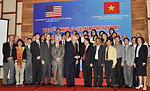 U.S. Ambassador to Vietnam David B. Shear and Dr. Le Ke Son, Office 33 Director, shake hands at the opening ceremony of the 8th JAC meeting.