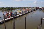 August 6, Shrimp boats, outfitted with oil boom, line the docks near Leeville, La