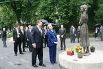 Secretary Clinton and Ukrainian Foreign Minister Place Flowers at Holodomor Memorial