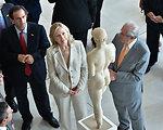 Secretary Clinton Looks at a Statue