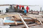 December 8, 2012 Loading up the boat among debris