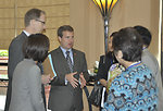 Acting Senior Deputy Assistant Administrator for Asia Jason Foley of USAID (center) talks to Ms. Phan Thi My Linh, Vice Minister of Vietnam's Ministry of Construction.