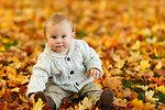 Boy in park in autumn