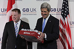 Secretary Kerry Receives a Case of Beer from Canadian Foreign Minister John Baird