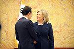 Secretary Clinton Is Greeted By Republic of Korea President Lee Myung-bak