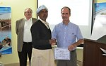 Ted Gehr, Director USAID Punjab, distributing training completion certificates to the dairy farmers enrolled under USAID-DRDF Dairy Project's Training Program.