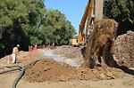 Work continues on 3,300 feet of seepage cutoff wall