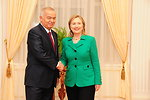 Secretary Clinton Shakes Hands With Uzbek President Karimov