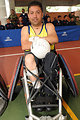 Colombian Wheelchair Rugby Player Shows Autographed Ball