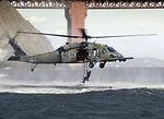 Pararescuemen climb up a moving HH-60G Pave Hawk
