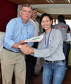 USAID Program Officer Director Michael Foster awards certificates to Red Cross workers.
