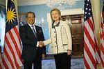 Secretary Clinton Shakes Hands With Malaysian Deputy Prime Minister and Education Minister Tan Sri Dato' Haji Muhyiddin Bin Mohd. Yassin