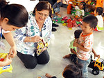 U.S. Deputy Chief of Mission Claire Pierangelo visits children at a preschool refurbished with USAID funds
