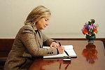 Secretary Clinton Signs Guest Book