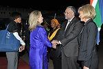 Secretary Clinton Is Greeted By Ambassador Rasool