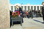 Secretary Clinton Places Carnations on the Monument