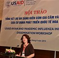 USAID Office of Health Director Laurel Fain addresses the USAID Avian and Pandemic Influenza Initiative Dissemination Workshop