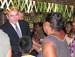 Assistant Secretary Campbell Shakes Hands With Local Residents
