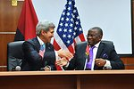 Secretary Kerry, Angolan Foreign Minister Chikoti Shake Hands After Meeting in Luanda