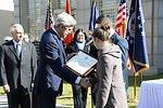 Secretary Kerry Presents an Award to Embassy Guard Akarsu's Family