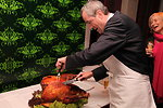 Ambassador Murphy Carves the Turkey for a Thanksgiving Celebration