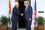 Secretary Kerry Shakes Hands With Indian External Affairs Minister Khurshid