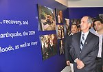 Provinicial Mission Director Punjab Ted Gehr and USAID team walking through the photos at gallery