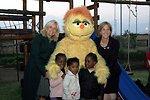 Dr. Jill Biden, Liz Berry Gips, South African Children, and Kami Pose for a Photo