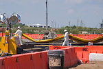 August 7, Carefully moving used oil boom for cleaning