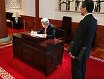 Secretary Kerry Signs Guest Book