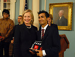 Secretary Clinton Awards Anup Poudel of Nepal the 2010 Democracy Video Challenge Prize