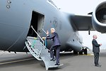Secretary Kerry Waves As He Boards Air Force Jet Flying Him to South Sudan