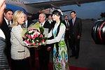 Secretary Clinton Receives Flowers From an Uzbek Woman