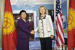 Secretary Clinton Shakes Hands With Kyrgyzstani President Otunbayeva