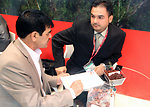 A Saudi Arabian buyer negotiates a possible deal with an Afghan businessman for the country's raisins. Afghan traders signed deals worth more than $2 million dollars during the first two days of the exhibition.