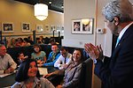 Secretary Kerry Says Hello to a Yale University Student and His Family at New Haven Pizza Shop