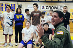 Air Force Reserve Command Surgeon General Col. Dominic DeFrancis laughs with students