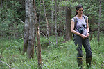 Sue Cameron hiking through a bog