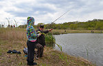 MN Valley National Wildlife Refuge employee Mike Malling assists student in a casting lesson.